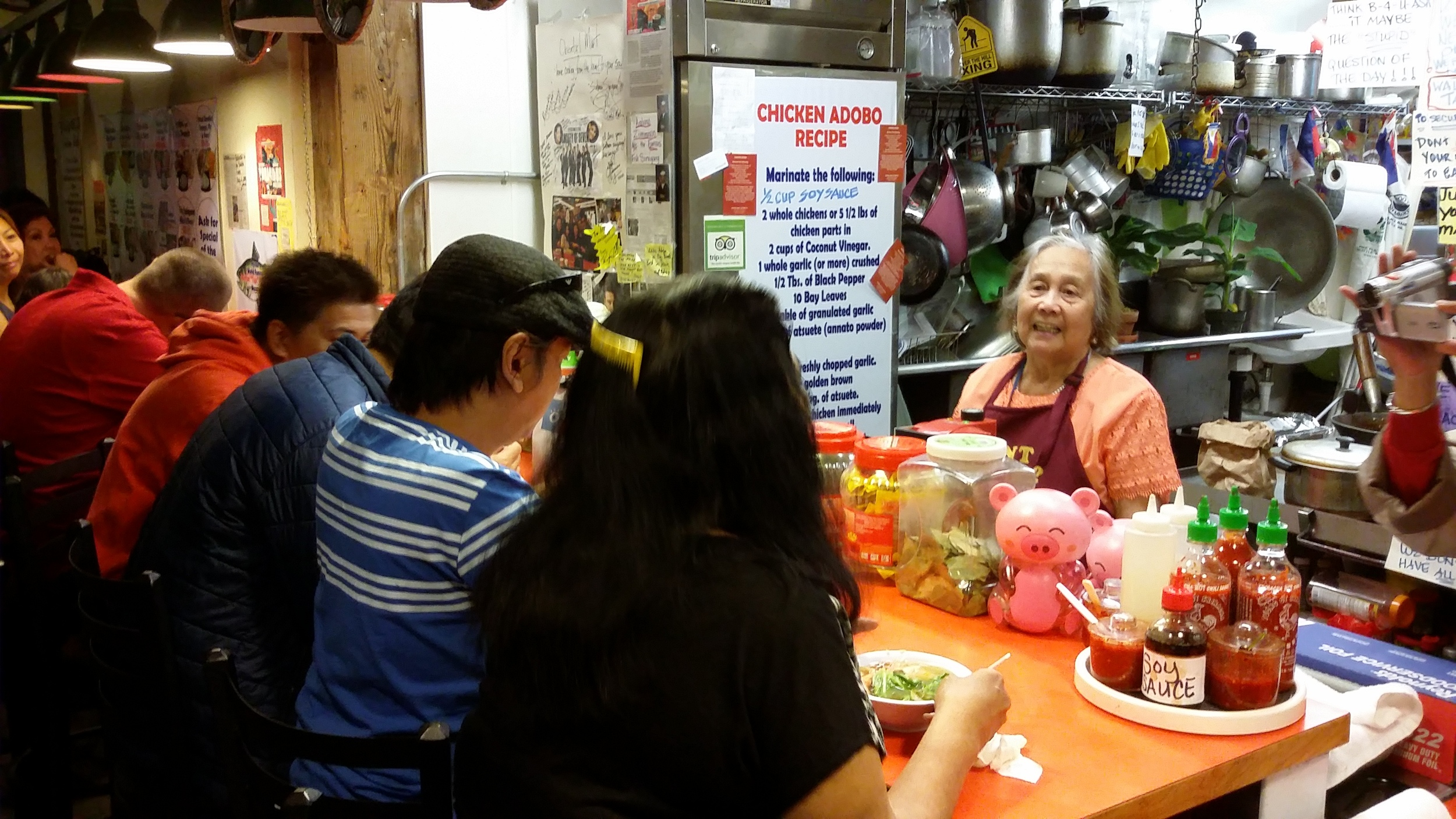 The matriarch of the Apostols, Milagros Guacen Apostol, makes sure Oriental Mart's customers eat well. (Photo by Elias M. Ferrer)