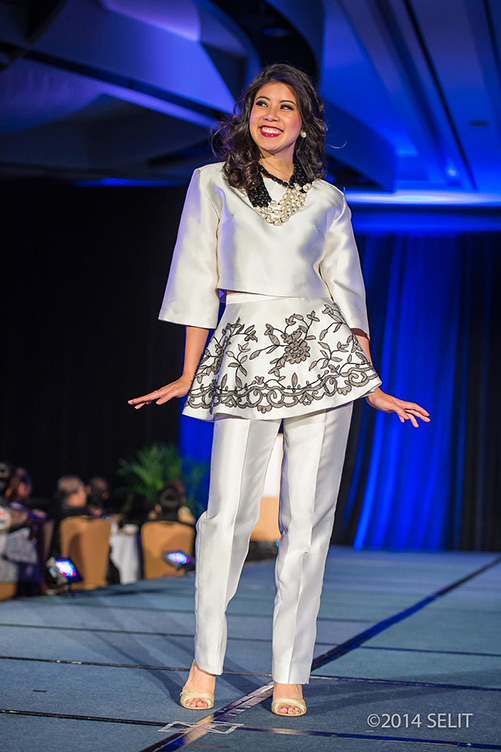 Silver gray three-quarter length bell sleeve crop top paired with matching lace appliqué peplum straight-legged pants  (Photo by   Selit Rapadas  /  UNIT ONE Photography Studio  )