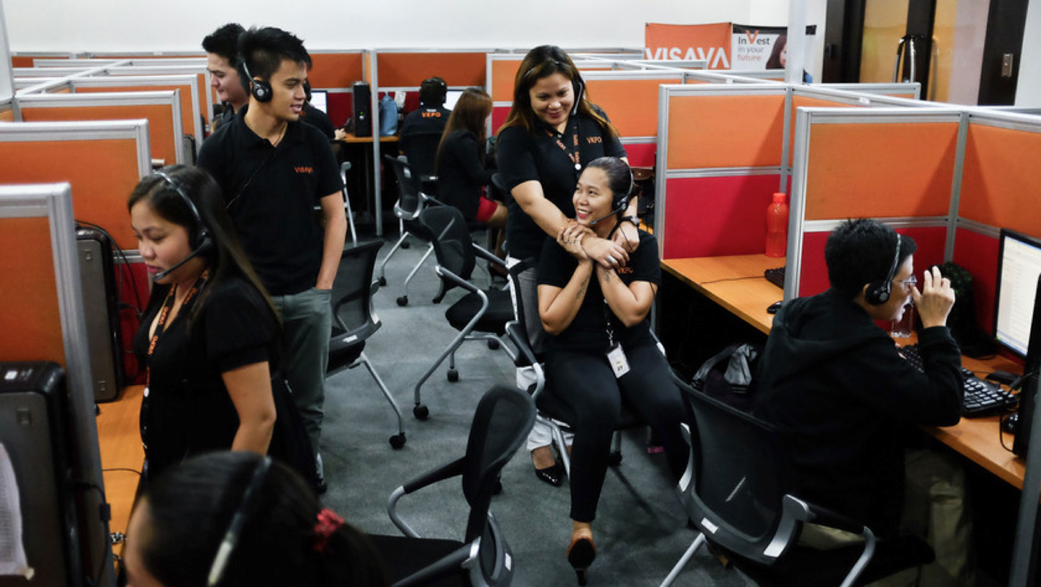 """Young Filipinos enjoying a moment off at one of the numerous call centers--the new economic lifeblood, in the old country where """"English-only"""" rules, rule. (Photo by Nacho Hernandez/Bloomberg Markets)"""