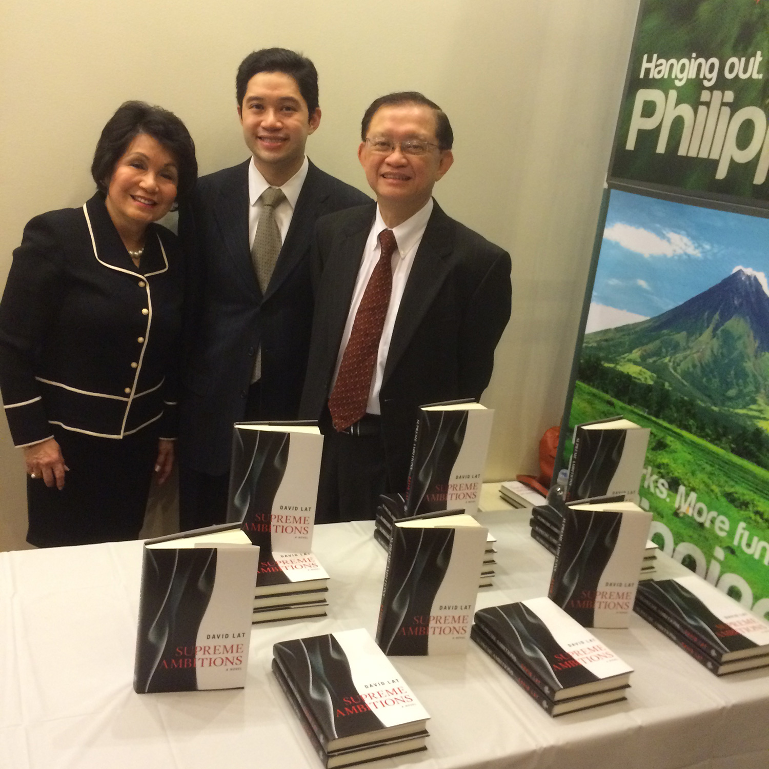 David with parents Dr. Zenda Garcia Lat and Dr. Emmanuel Lat at the  Supreme Ambitions  book launch at the Philippine Center in New York. (Photo courtesy of David Lat)