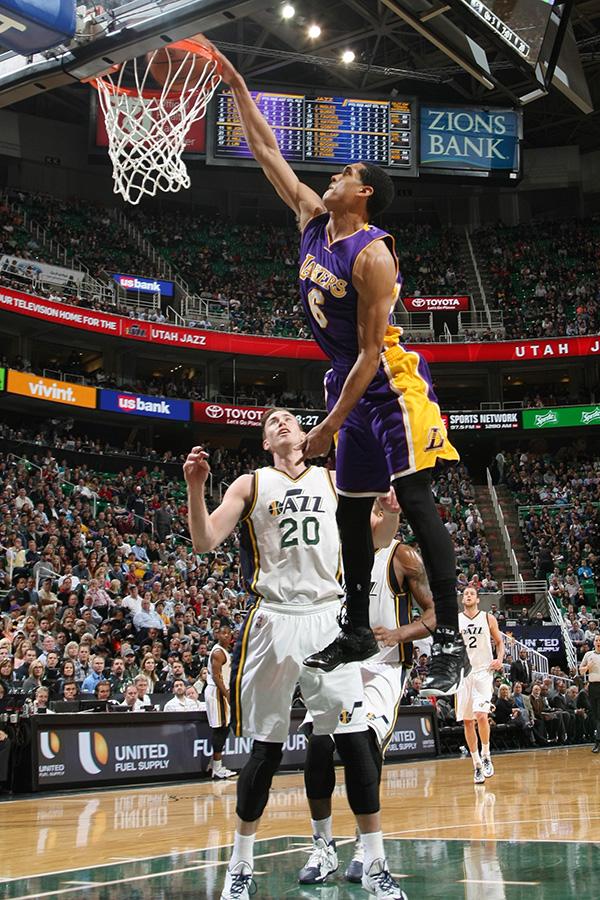 Lakers' rookie point guard Jordan Clarkson dunks over Utah Jazz forward Gordon Hayward (Source: NBA Photos/Los Angeles Lakers)