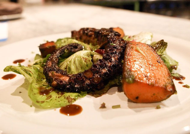 Soy-vinegar braised octopus, coconut oil confit kamote, chicories, and black garlic & cilantro vin (Photo courtesy of LASA Restaurant Project)