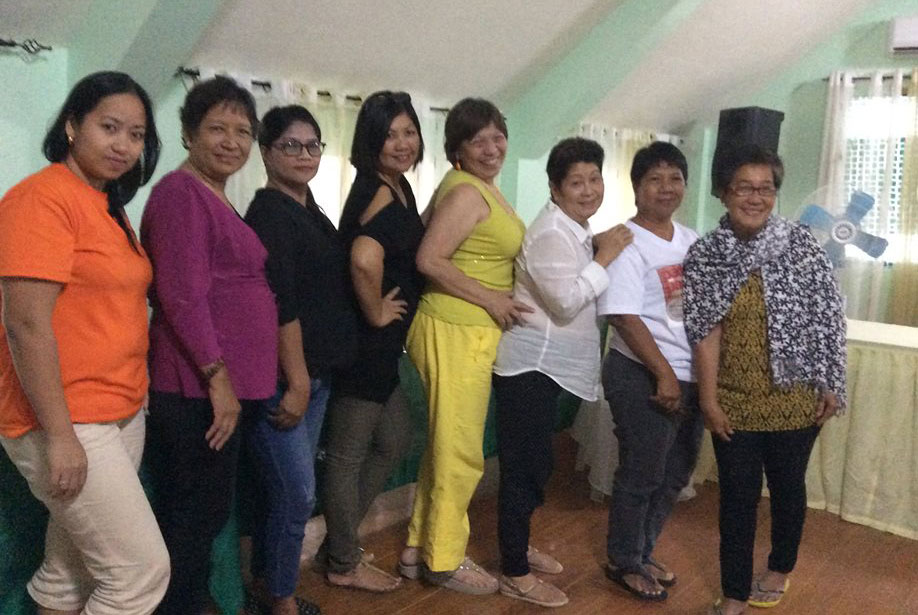 Dr. Margarita Holmes (fourth from right)with Typhoon Haiyan survivors during a recent two day psychosocial activity (Photo courtesy of WeDpro)