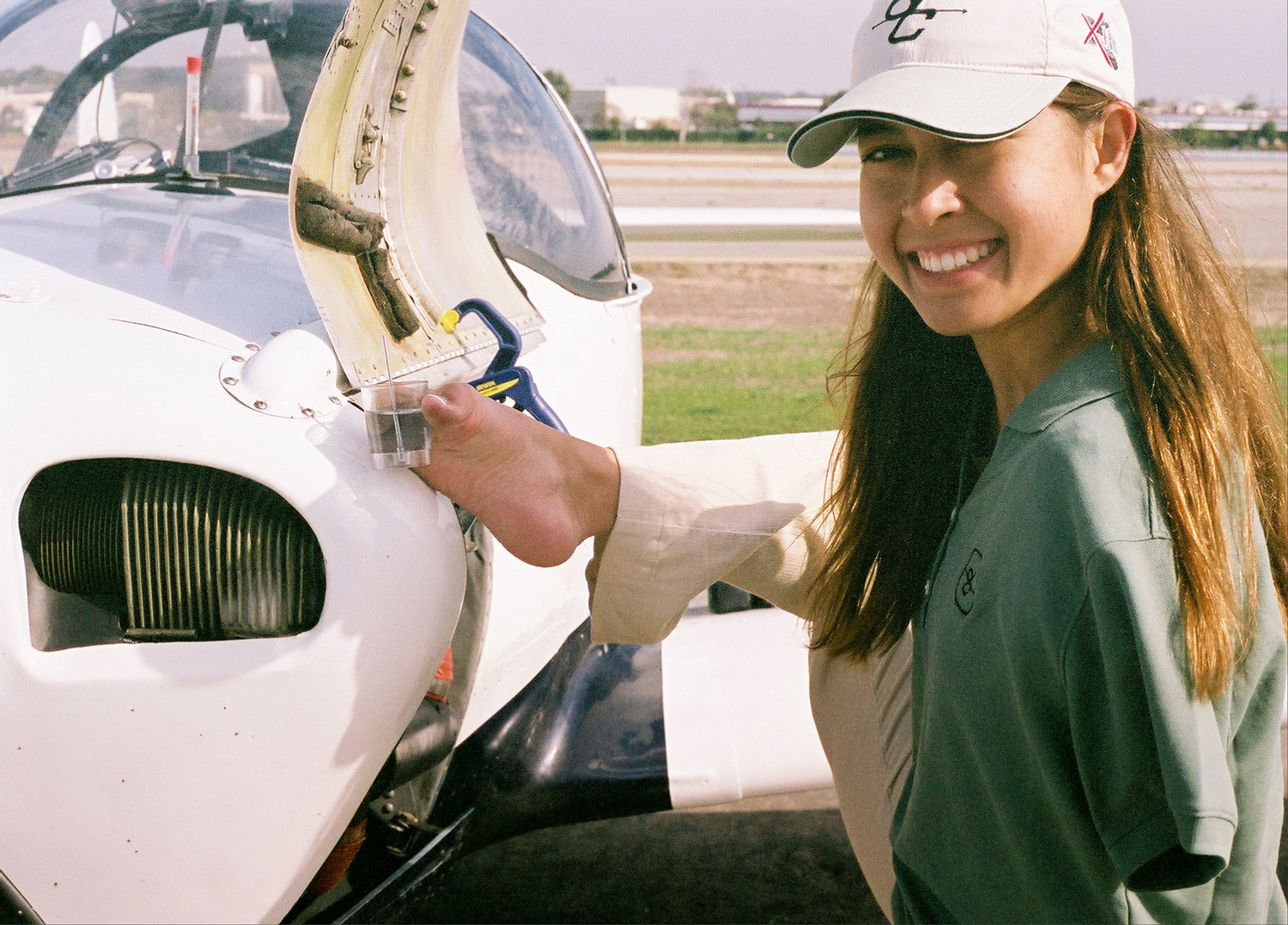 Jessica checking on her plane before take-off  (CourtesyofJessicaCoxMotivationalServices)