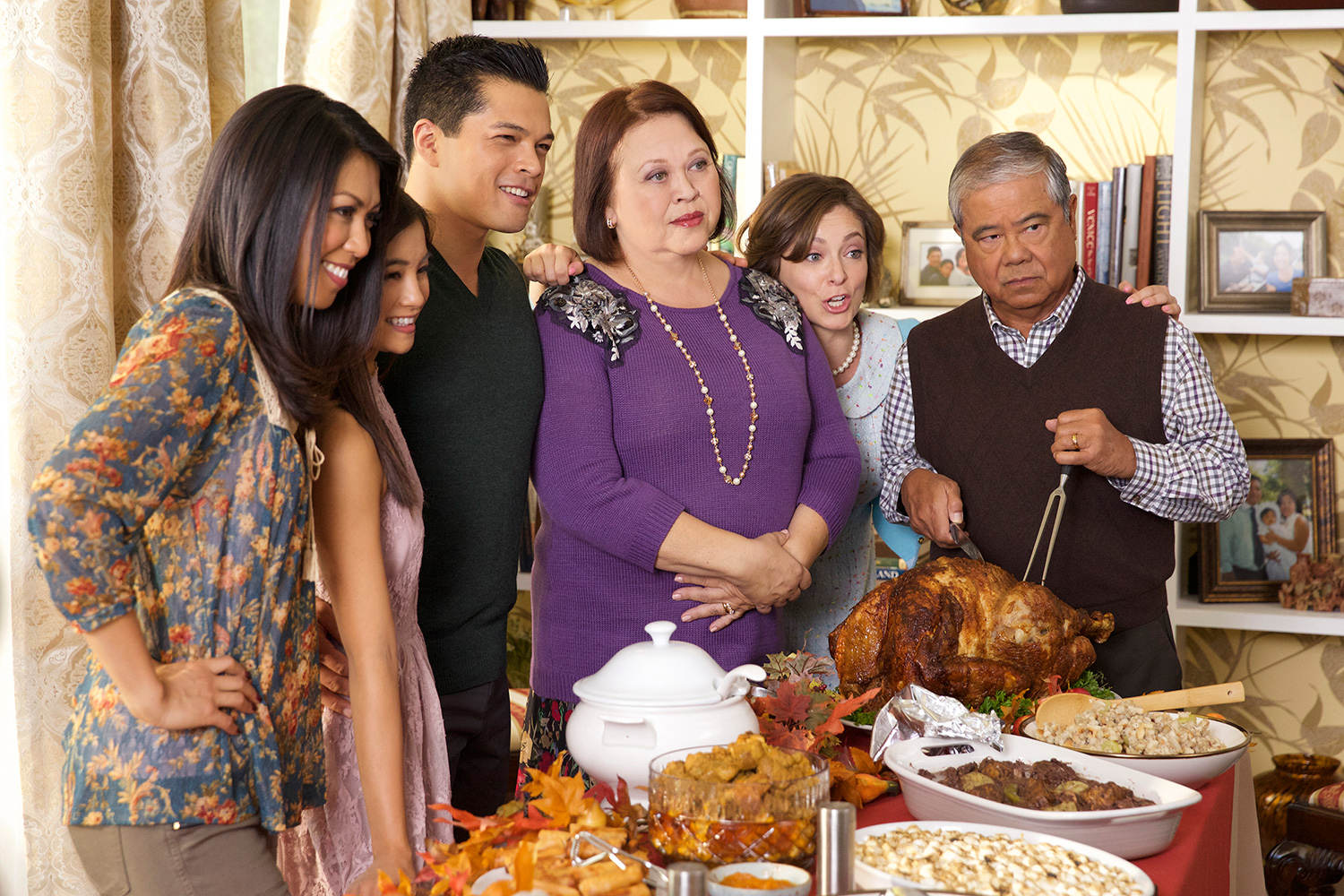 "Crazy Ex-Girlfriend — ""My First Thanksgiving With Josh!"" Pictured (L-R): Tess Paras as Jayma, Coryn Mabalot as Jastenity, Vincent Rodriguez III as Josh, Amy Hill as Lourdes, Rachel Bloom as Rebecca and Alberto Isaac as Joseph (Photo: Tyler Golden/The CW © 2015 The CW Network, LLC. All rights reserved)."