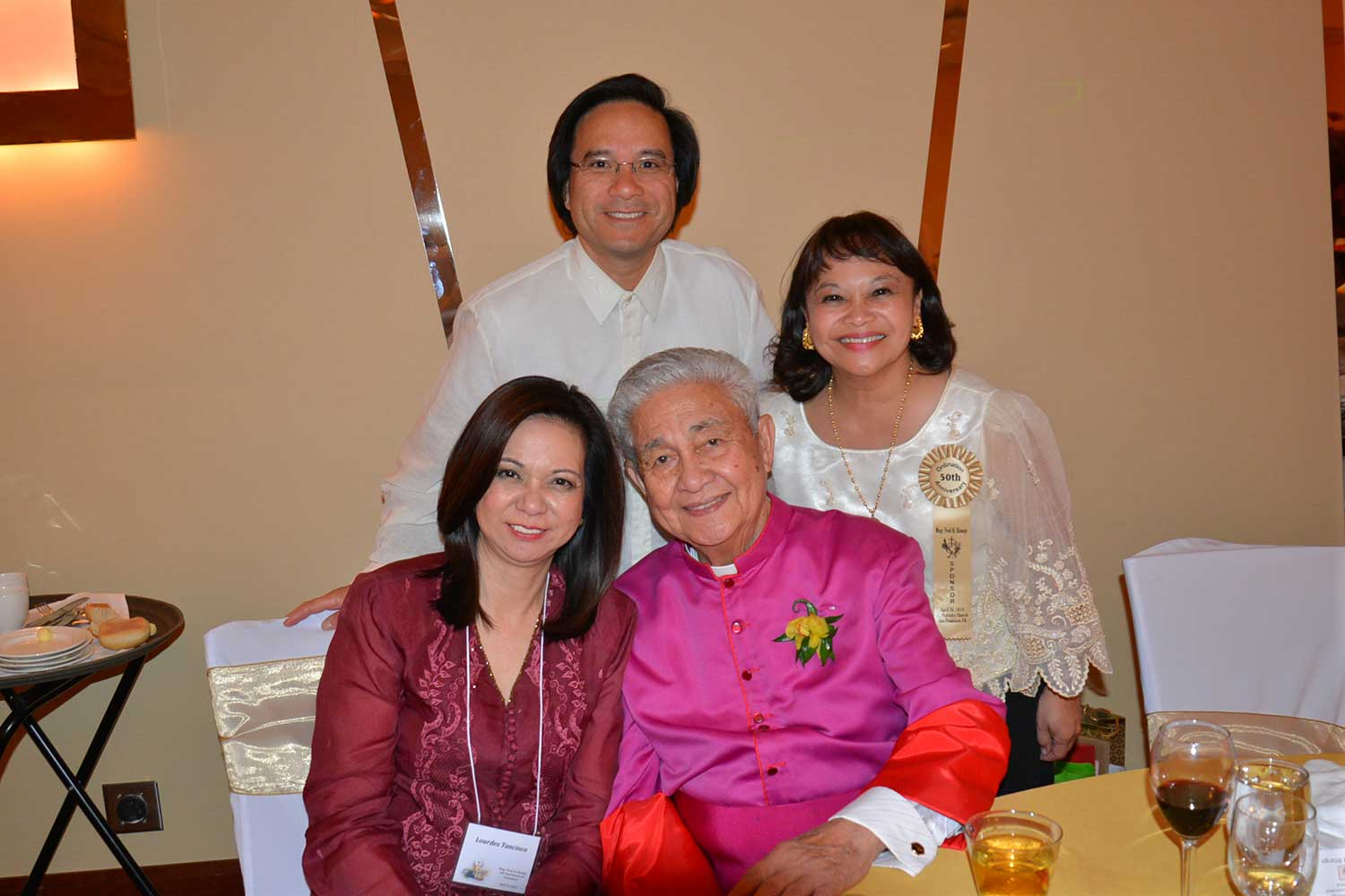 The author with Monsignor Fred Al Bitanga on his 50th Anniversary of his Ordination to Priesthood, April 26, 2014. With Tony and Bernadette Sy (Photo courtesy of Lourdes Santos Tancinco)