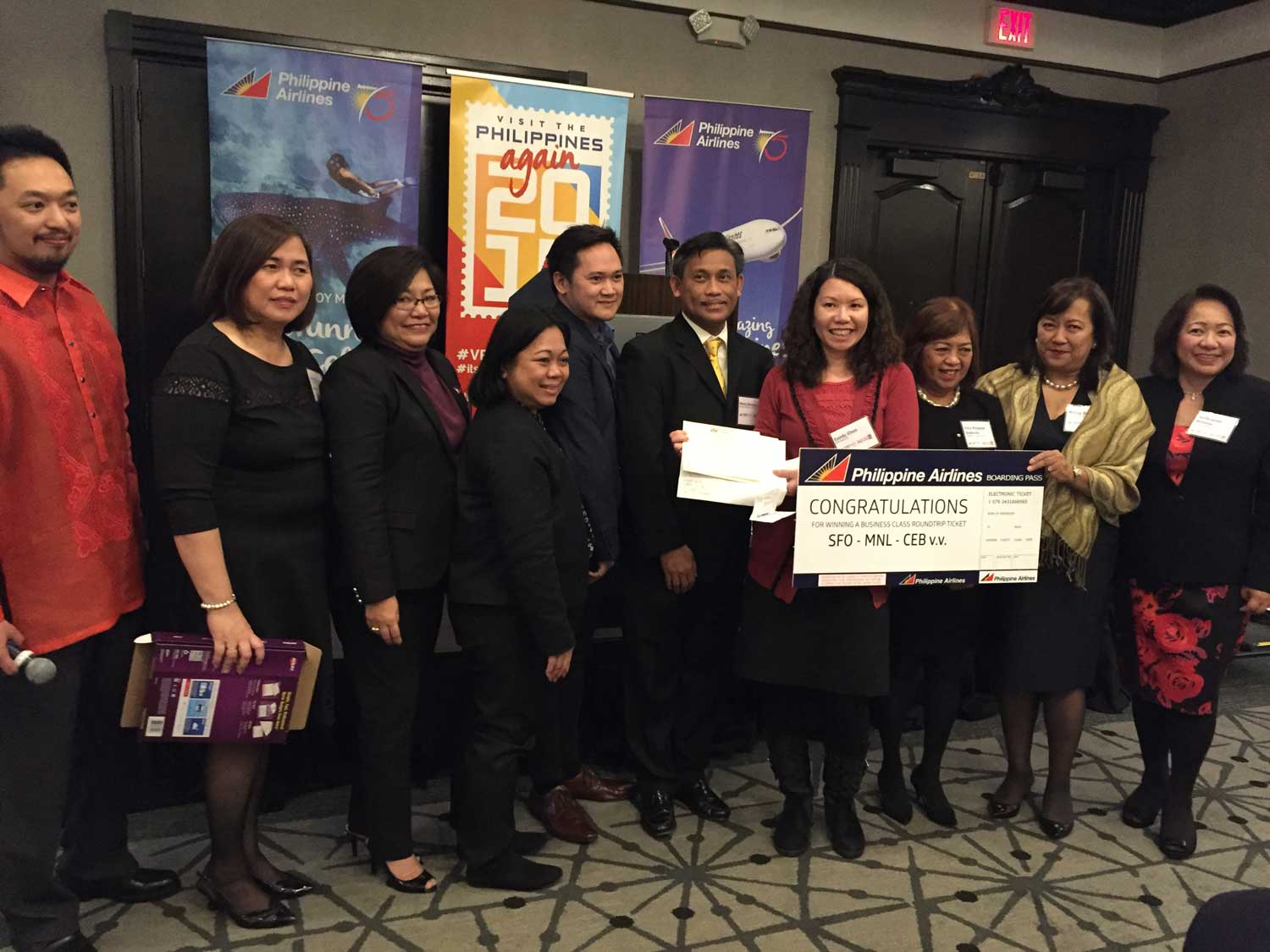 Presenting the raffle prize airline tickets were Consul General Henry Bensurto, Jr., (6th from left), PAL's Marila Revilla (2nd from right) and DOT Director Purificacion Molintas (right).