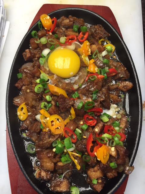 Purple Patch D.C. offers a spicy, sizzling Pork Sisig appetizer, a customer favorite.  (Photo courtesy of Purple Patch D.C.)