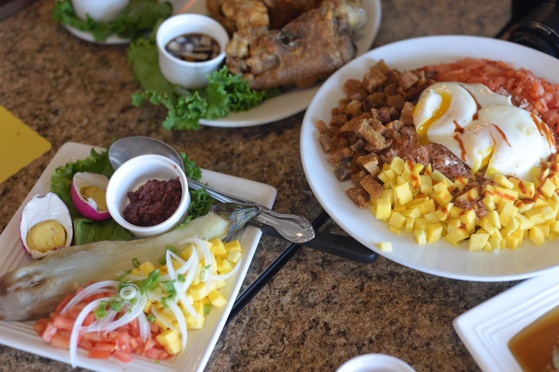 Hinamburang Talong and Bagoong Rice Medley (and Crispy Pata in the background). Dishes are served family-style. (Photo by   Sunantha Mendoza-Quibilan)
