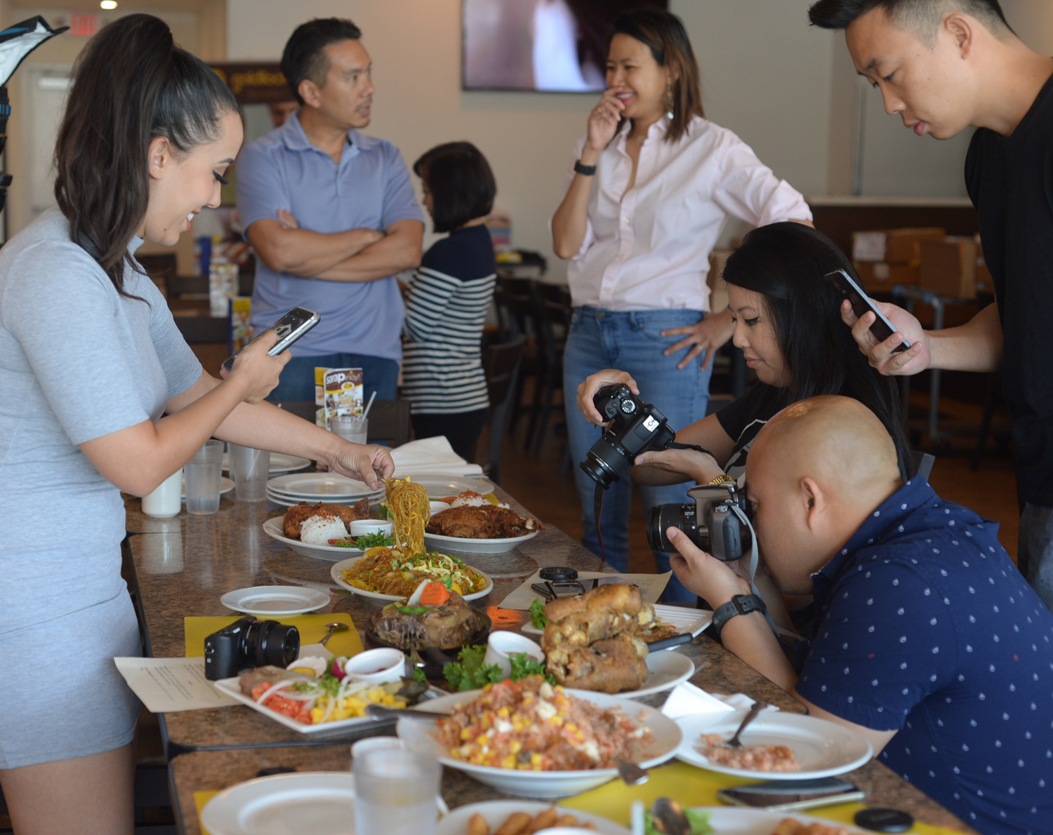 Varissa Brum (@misoo_hungry), Miralyne Ung (@omgitsbomb), Joey Ngoy (@jofieats) and Jeremy Lu (@socaleatery) take pictures of the lunch spread. (Photo by   Sunantha Mendoza-Quibilan)