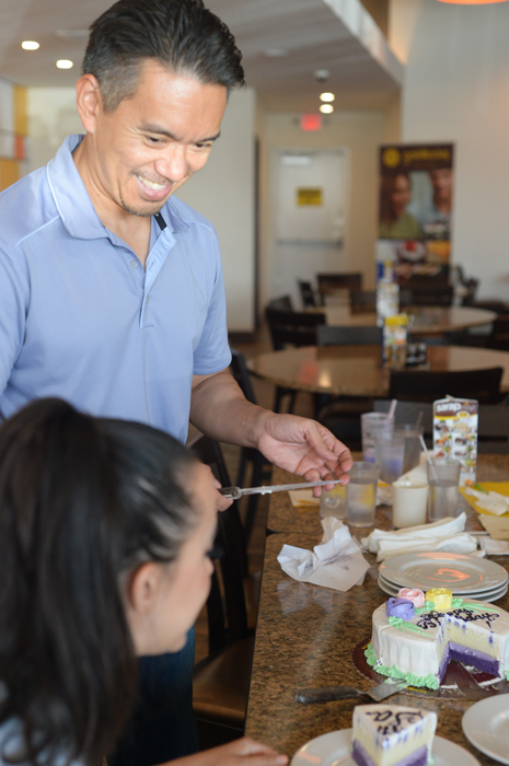 Owner Rob Yee serves the Ube Tres Leches cake. (Photo by   Sunantha Mendoza-Quibilan)