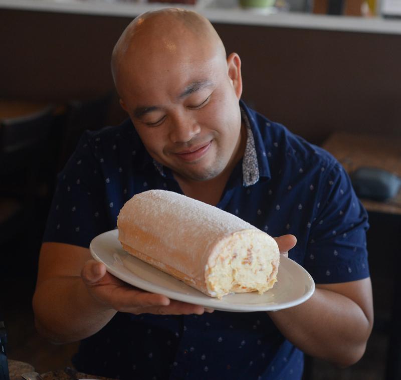 Joey Ngoy (@jofieats) cradles a roll of Frozen Mango Brazo. (Photo by   Sunantha Mendoza-Quibilan)