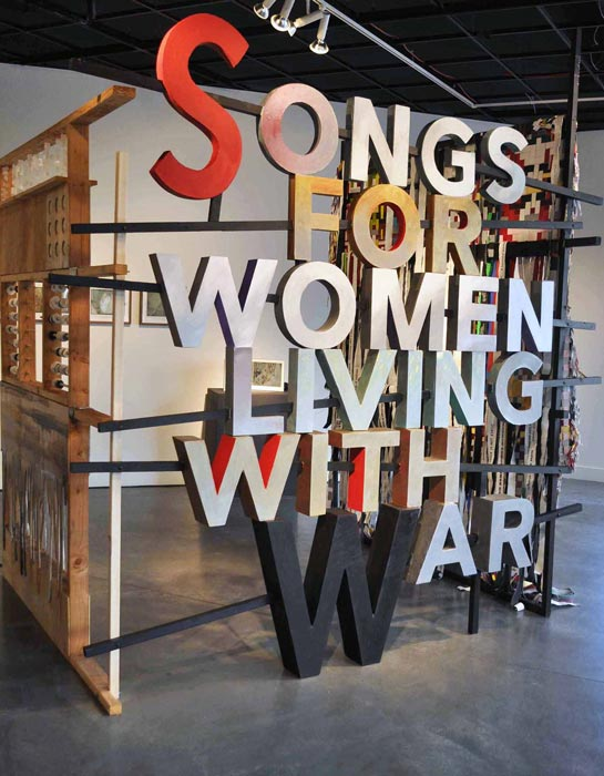 """Bahay ni Lola  by Johanna Poethig   at the  Songs of Women Living With War  exhibition, Pro Arts, Oakland, 2016. Artworks graphically and viscerally narrate struggles and include a video of a """"comfort woman"""" reacting to the newly installed plaque in Manila commemorating their WWII role during the Japanese occupation, conceptual pieces and sound art. (Photo © Johanna Poethig)"""