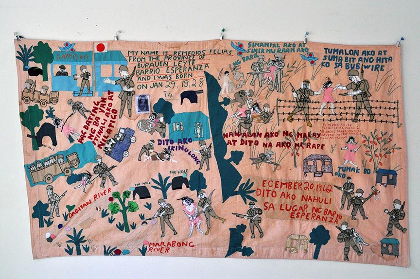 Lola Remedios, quilt, at the  Songs of Women Living With War  exhibition, collection of M. Evelina Galang. (  Photo  © Johanna Poethig)