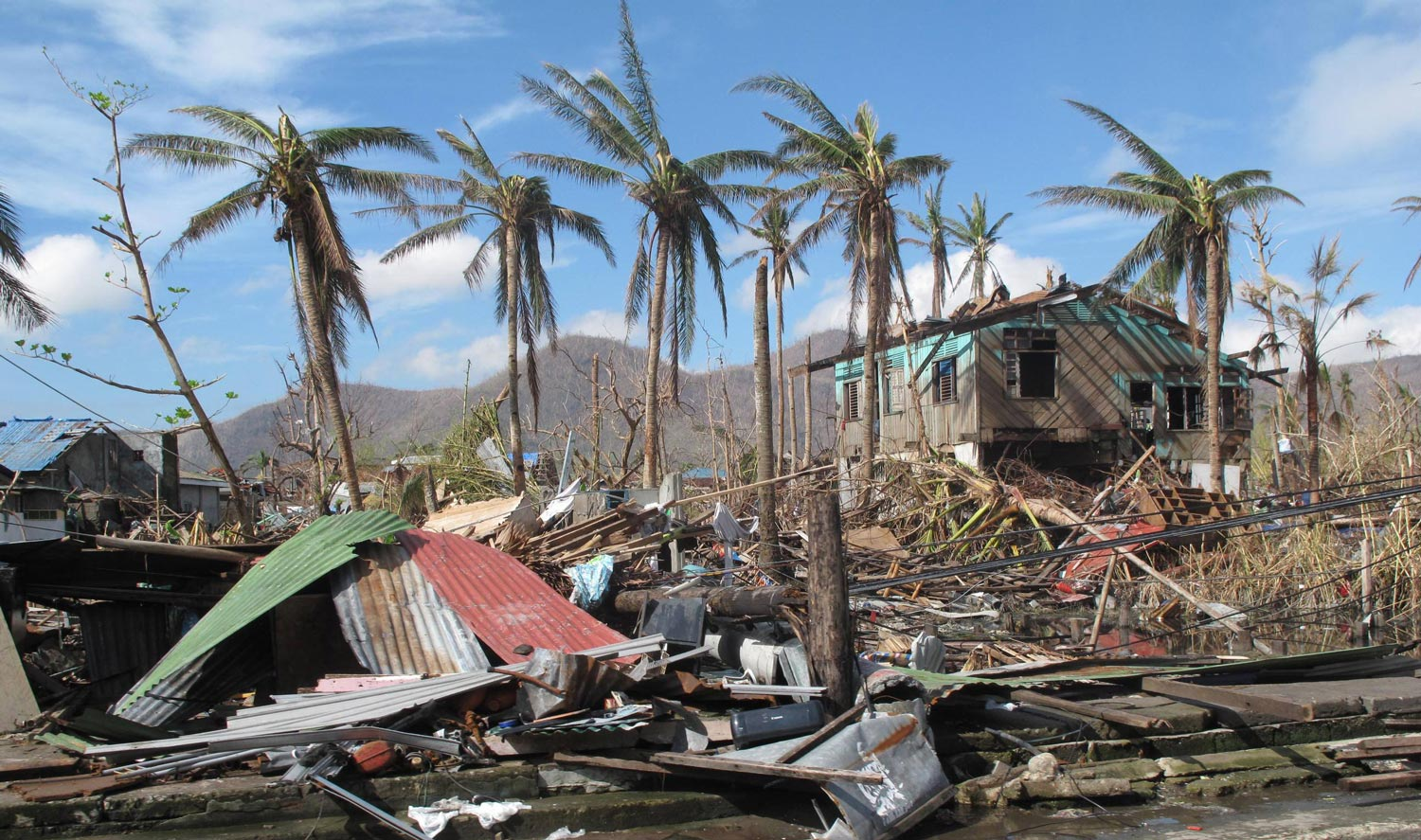 Destruction caused by Typhoon Haiyan in Tacloban, Philippines, 2013 (Photo by Henri Donati/Department for International Development, UK)