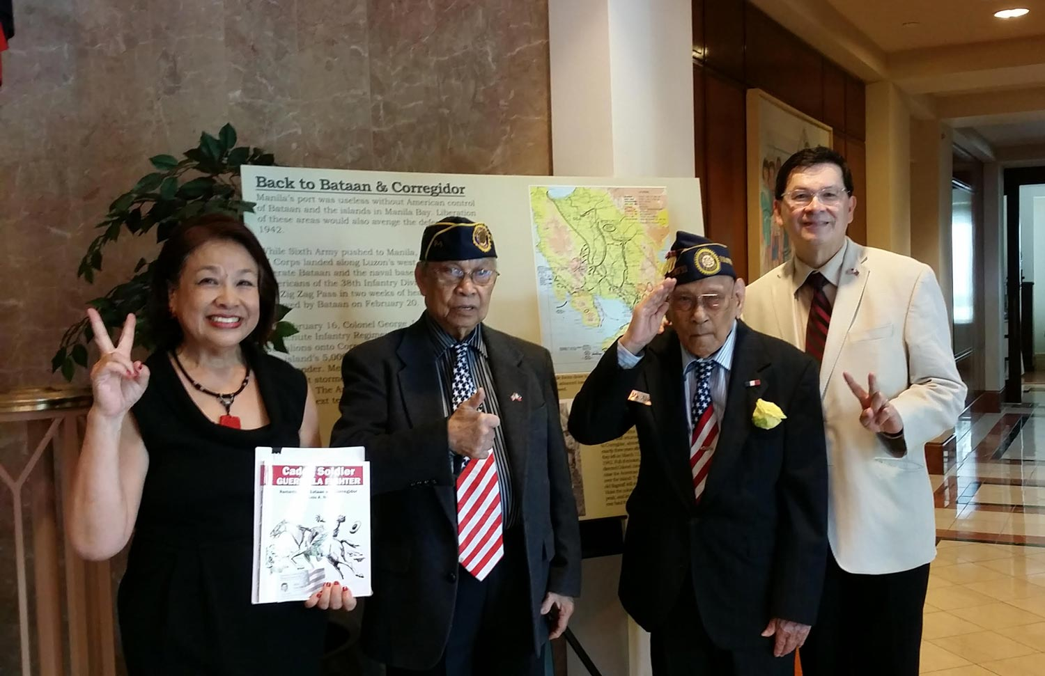 """Celestino Almeda, 99, USAFFE veteran and Rudy Panaglima, 87, Recognized Filipino guerrilla who joined the resistance as a 14-year-old, attend the book launch of Cadet, Soldier, Guerrilla Fighter at the Philippine Embassy in Washington DC, with book editor Pepi Nieva, and Eric Lachica of The Filipino Veterans Recognition and Education project (FilvetsRep). Donate $20 or more to the FilvetsRep and receive a copy of """"Cadet, Soldier, Guerrilla Fighter"""" through the month of June. Donations will help veterans receive the US Congressional Gold Medal recognizing their service."""
