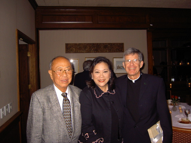 Dinner after the conferment of an honorary degree in 2005.  With Fr. Steve Privett, S.J., president of USF.