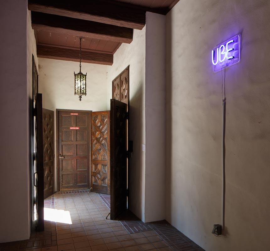 """The UBE neon sign announces the celebrity status of the lowly root in the corridor entrance to the Mills Art Museum. """"SOMA Pilipinas will be the new Filipino corridor—an ube corridor,"""" France noted. (Photo by © Phil Bond)"""