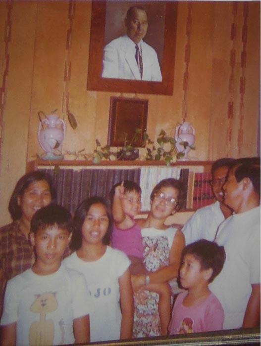 Cousins congregating beneath THE Official Lolo portrait