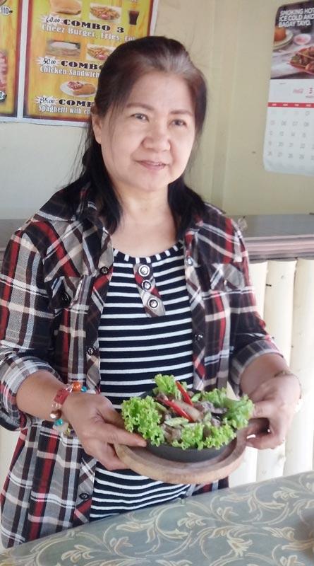 Aurea Doria Dacasin of Hapag-Kainan sa Ballesteros cooks  dinakdakan  like nobody else. (Photo by Elsie Pablo Fernandez)