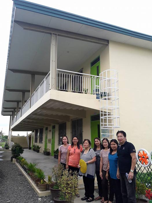 The author, third from left (in striped shirt), and brother retired Manila City Fiscal Roy Cabatuando (extreme right), with school principal Mrs. Evelyn Policarpio (second from left in orange shirt)and a few teachers in front of the annex building of Sta. Cruz National High School in Sta. Cruz, Gapan City, Nueva Ecija. (Photo by Jay Cabatuando