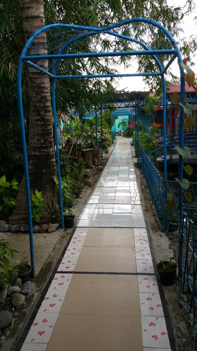 Path of tiles that leads to my eldest brother Joe's housing project.(Photo by Patria Rivera)