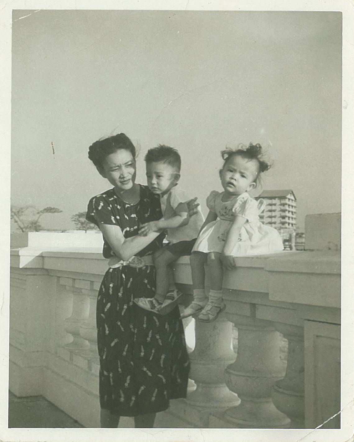 My Mom with my brother Papu and my cousin Angele Baizas in Luneta in 1948 with what remained of Manila Hotel after the bombing of Manila in the background. (Photo courtesy of Maripi Leynes)
