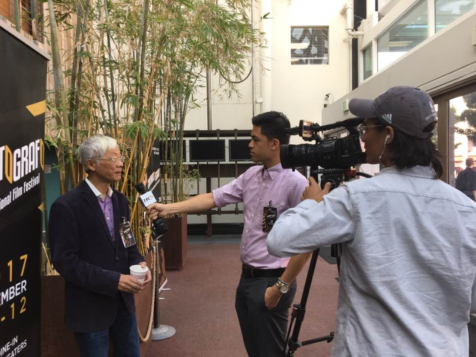 """San Francisco Arts Commissioner At Large Gregory Chew (left) being interviewed by the BA team said  """"We're always invisible, especially when it comes to mainstream media. We have to tell our stories.""""  (Photo courtesy of Pia Lopezbanos-Carrion)"""