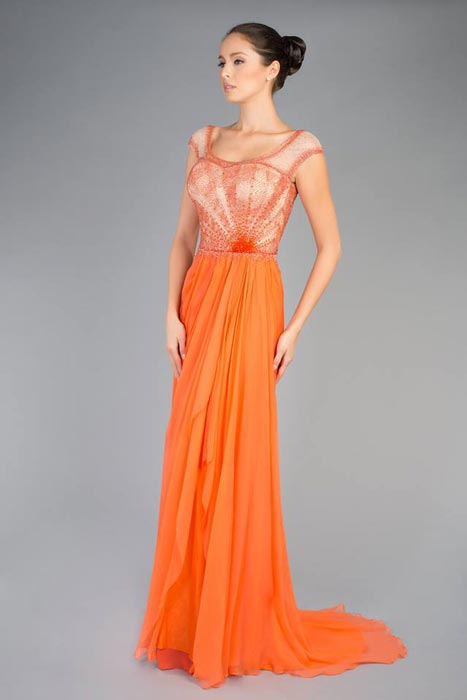 A very classic, orange-sherbet silk chiffon gown with hand-beaded bodice and cap sleeves. Very soft, very feminine lines.
