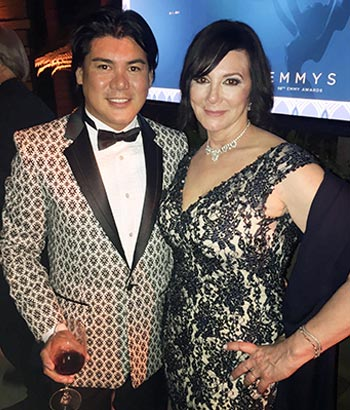 Oliver with former LA prosecutor, Marcia Clark, of O.J. Simpson trial fame. Oliver is wearing his own custom-design tuxedo and Ms. Clark is in an evening gown designed by him. This was at the 2016 Primetime Emmy Awards show.