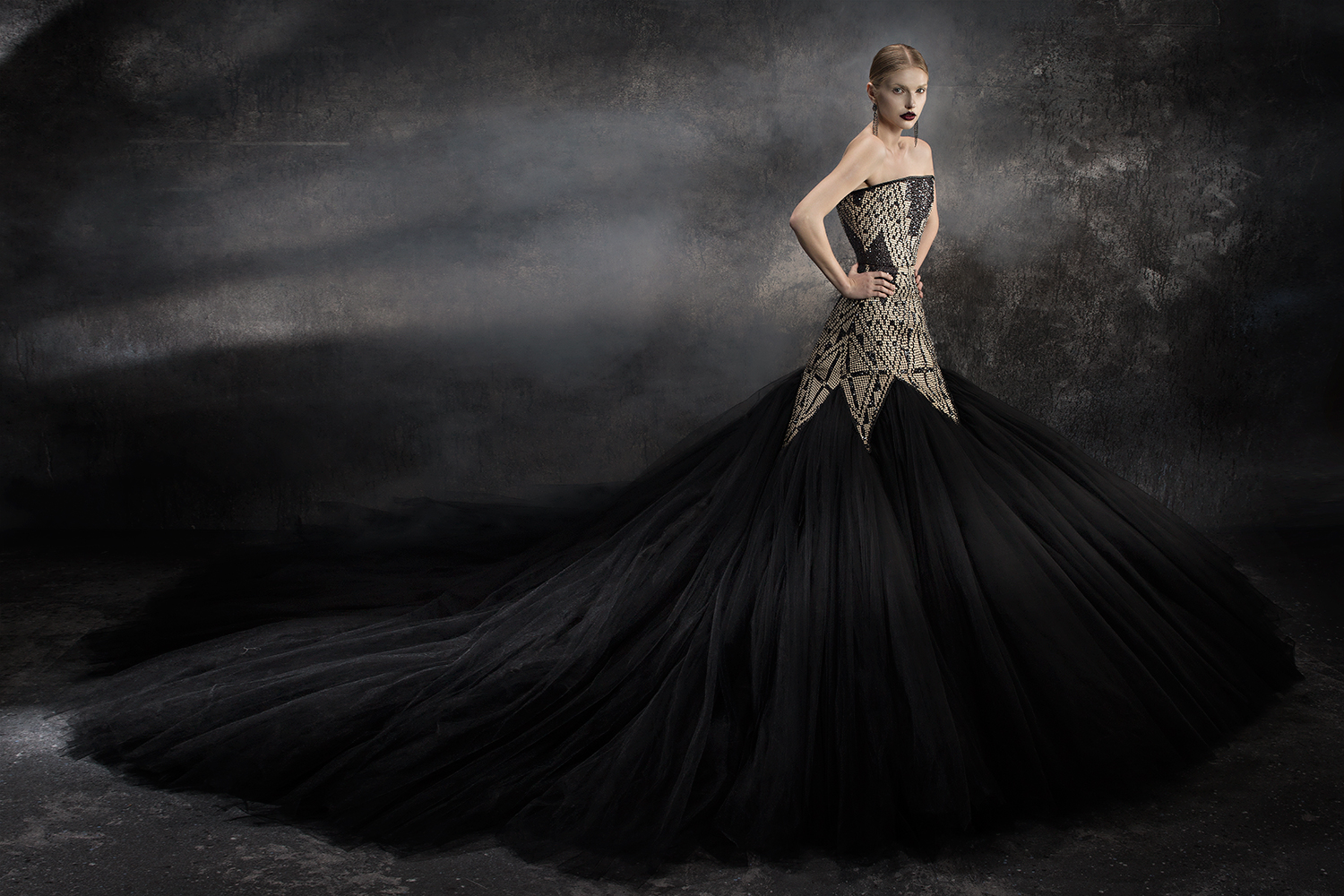 Handwoven hybrid of native material from the Philippines and layers of black tulle.