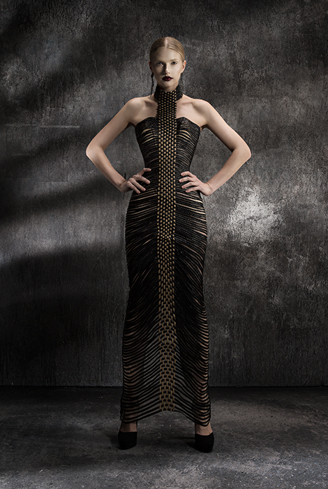 Hand woven, finely braided leather weaved dramatically into a long evening dress.