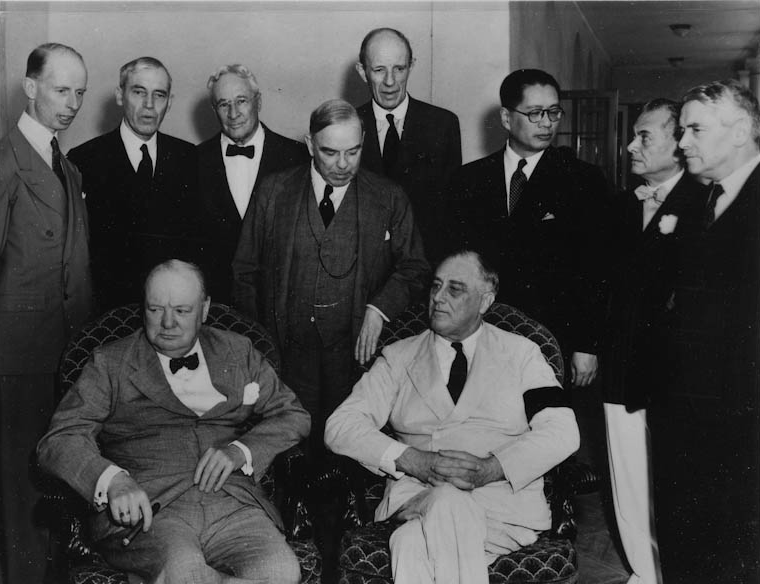 Franklin D. Roosevelt and Winston Churchill with (standing from left to right) Leighton McCarthy, Van Kleffens, Sid Owen-Dixon, MacKenzie King, Lord Halifax, T.V. Soong, President Quezon, and Walter Nash for the Pacific War Council in Washington, D.C. June 25, 1942 (Photo courtesy of the Franklin D. Roosevelt Presidential Library and Museum, Hyde Park, New York)