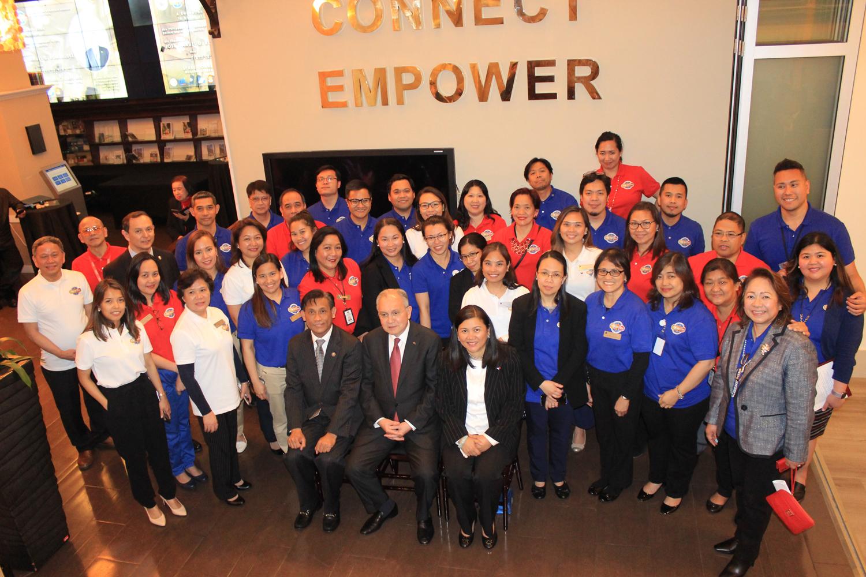Philippine Consulate staff greet Ambassador Jose Manuel Romualdez on his visit.