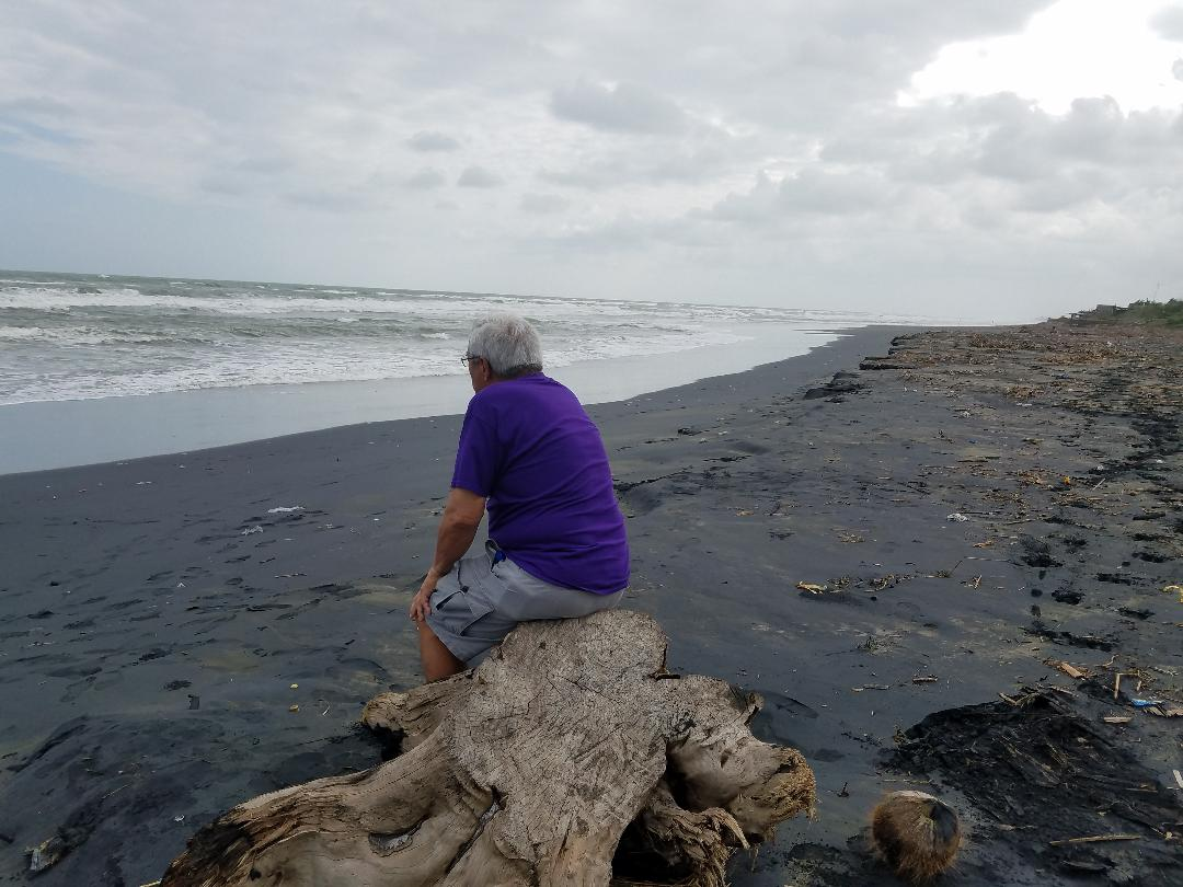 My father communes with the West Philippine Sea, of which its salty breeze my grandfather breathed in Ballesteros 100 years before. (Photo courtesy of David R. Rabaja)