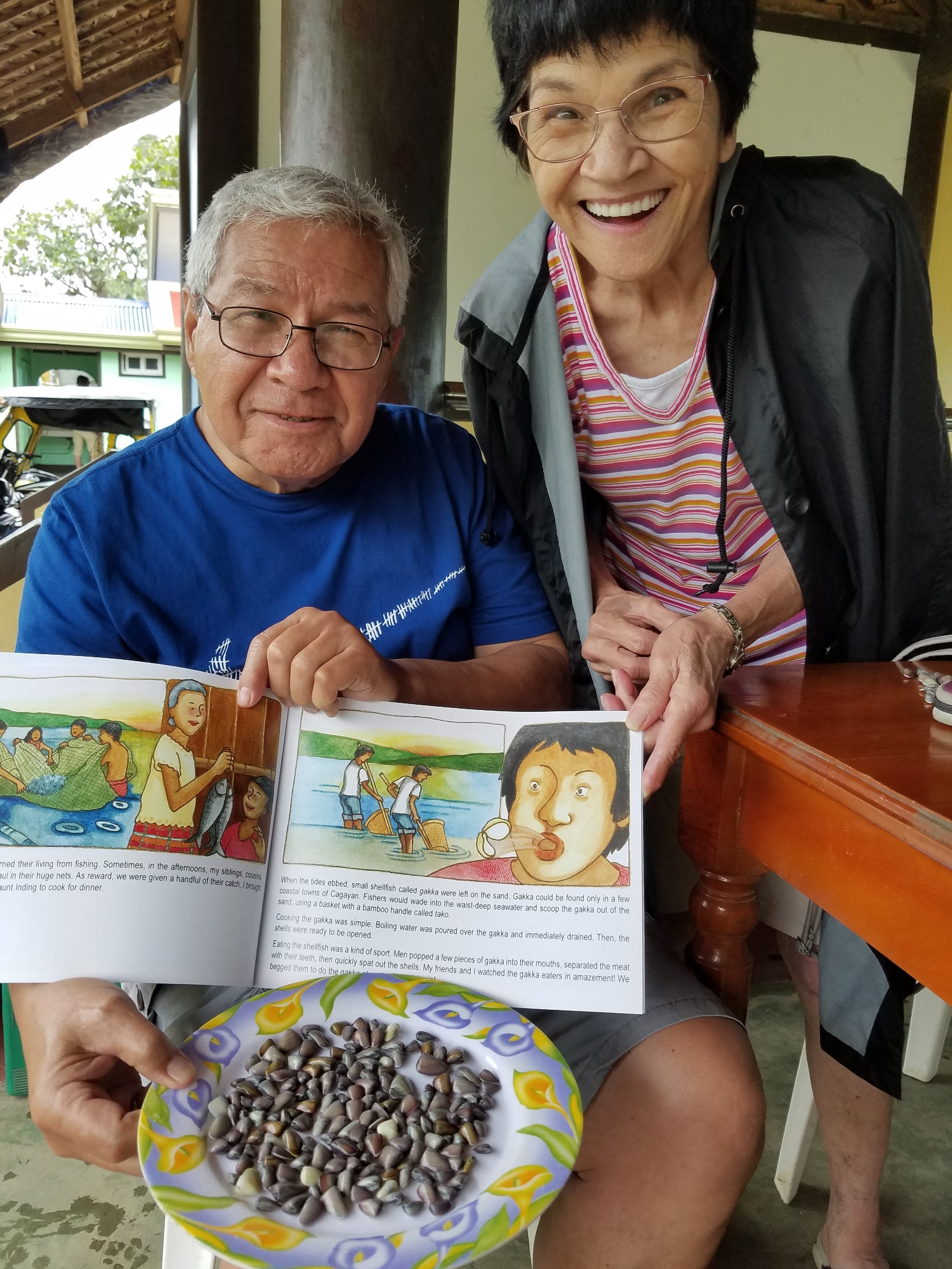 My dad and Aunt Rose are delighted with the shellfish gakka, which is immortalized in the book,  Ballesteros on My Mind: My Hometown in the Philippines.  (Photo courtesy of David R. Rabaja)