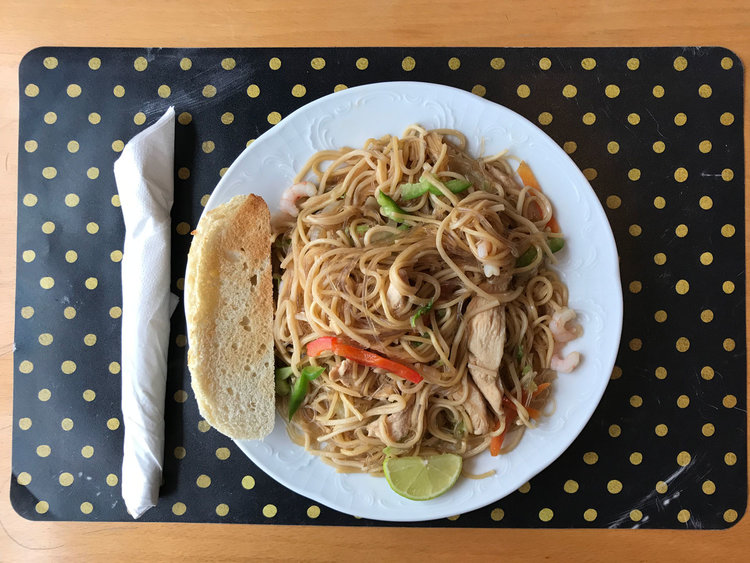 Matstofan's pancit canton, served with a side of white bread.