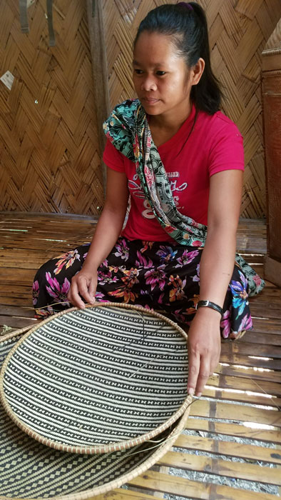 Kamantian villager with her bamboo trays. (Photo by Jill Stanton)