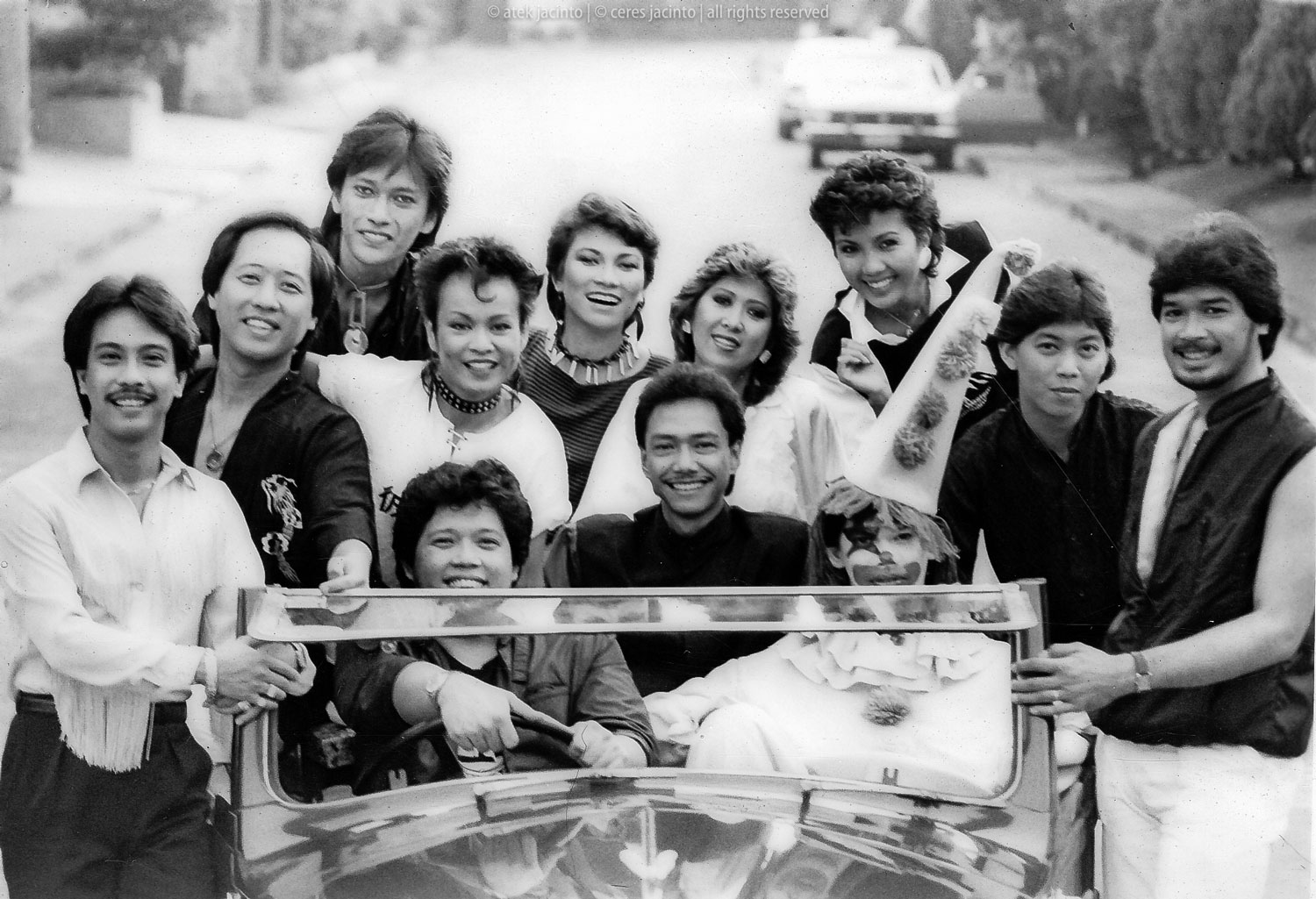 The Circus Band. Front Row: Hajji Alejandro, Paco Gamboa (bass guitar)+, Rudy Lozano (lead guitar)+, Clown mascot in place of Pabs Dadivas who had not arrived yet from the U.S., Boy Katindig (multi-digital keyboards), Walter Calinawan (drums)+  Second Row: Gerry Paraiso (piano)+, Ceres Jacinto, Basil Valdez, Jacqui Magno, Tillie Moreno, Pat Castillo (Photo by Jaime Zobel)