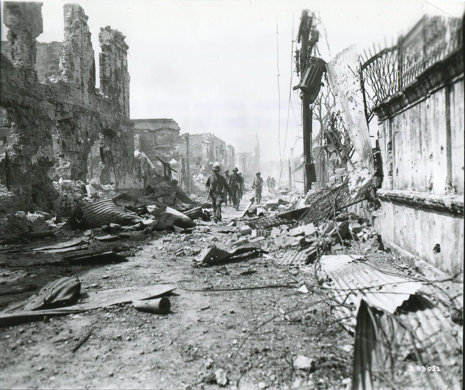 A platoon of American troops move into the Walled City on February 23, 1945. (National Archives)