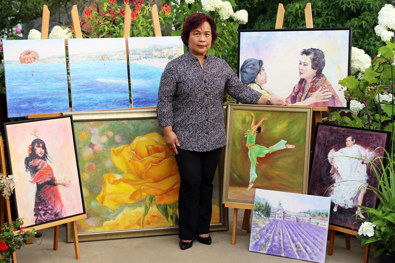 Esmie Gayo McLaren and her paintings (Photo courtesy of Esmie Gayo McLaren)