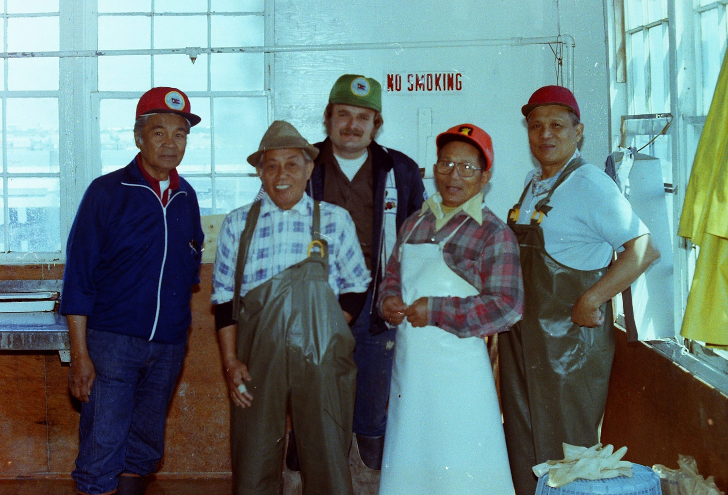 Filipino cannery workers posting with Steve Gillon (back), a machinist. (Photo by Tom Connelly, 1979)