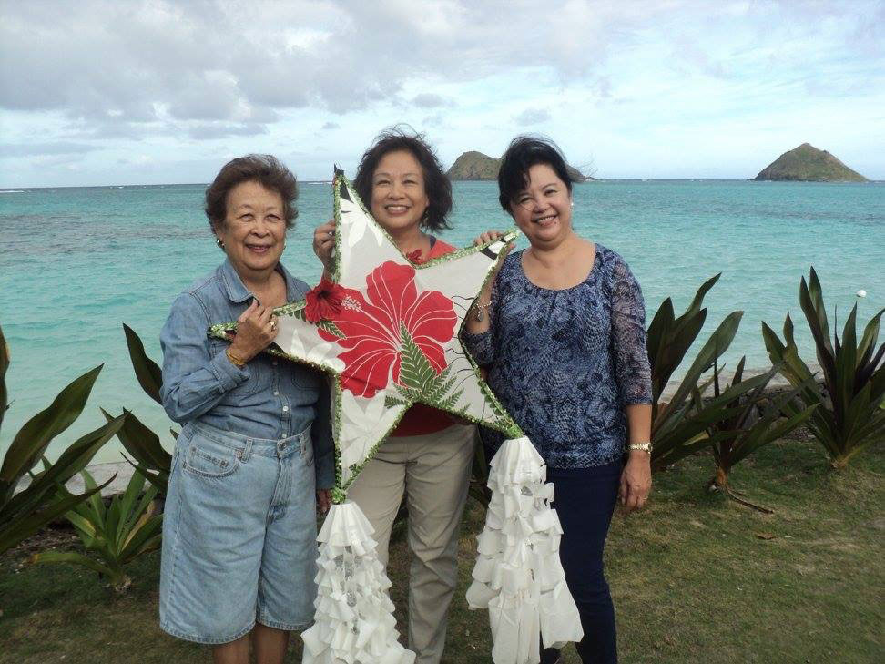 Lindy(left) at FAUW (Filipino Asspciation of University Women) parol making workshop, held beachfront in Lanikai, Oahu, with author Pepi Nieva and Cecile Joaquin Yasay.