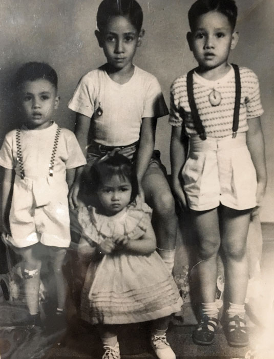 The Peñaranda siblings with a cousin (the small boy on the left). The author is on the right, elder brother Gil is in the middle.
