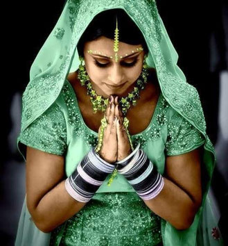 "Namaste . (One meaning is ""I bow to/honor you."")"