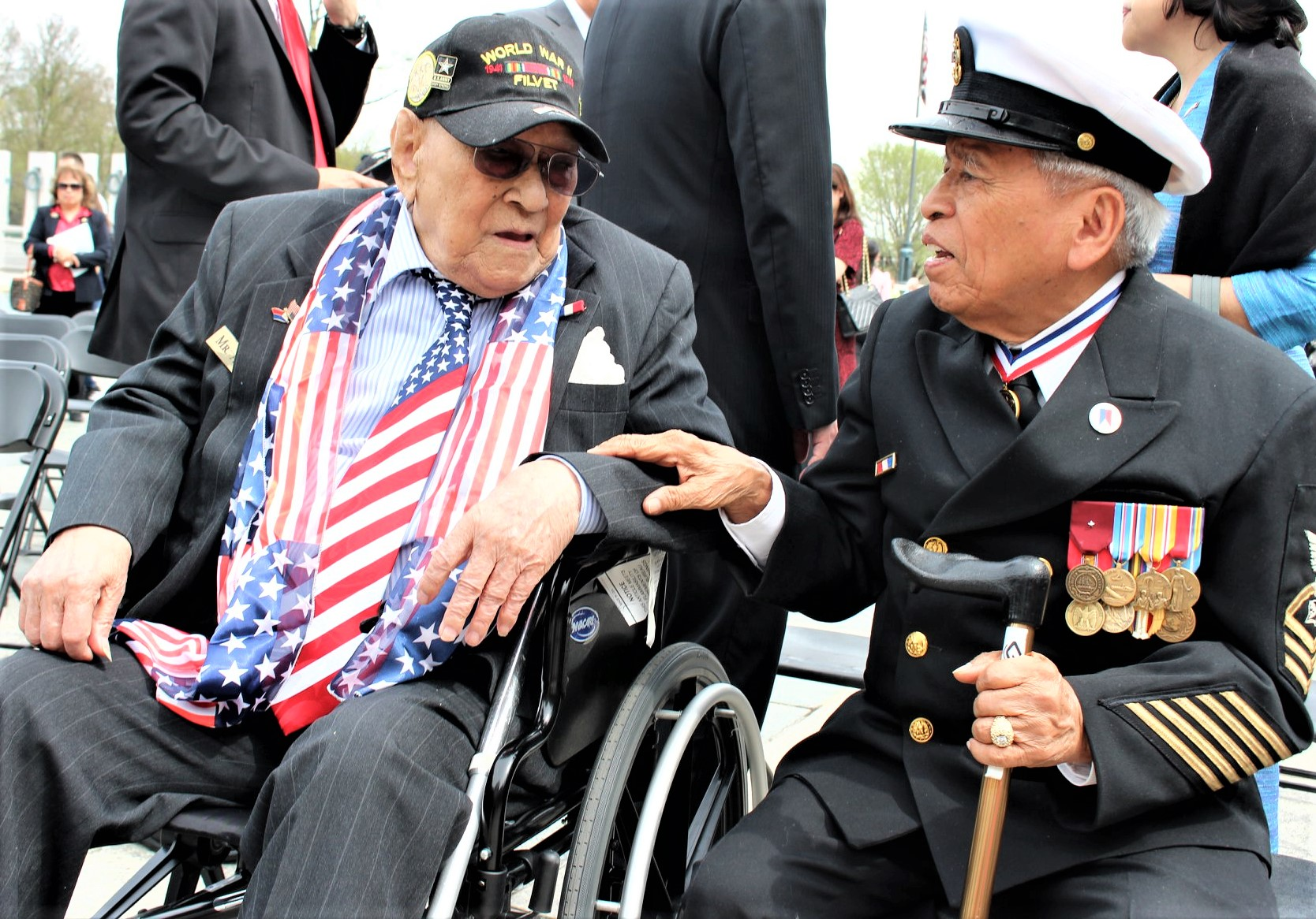 Filipino World War II Veterans Celestino Almeda (left) and Rey Cabacar share a light moment after the solemn ceremony. (Photo by Bing Branigin)