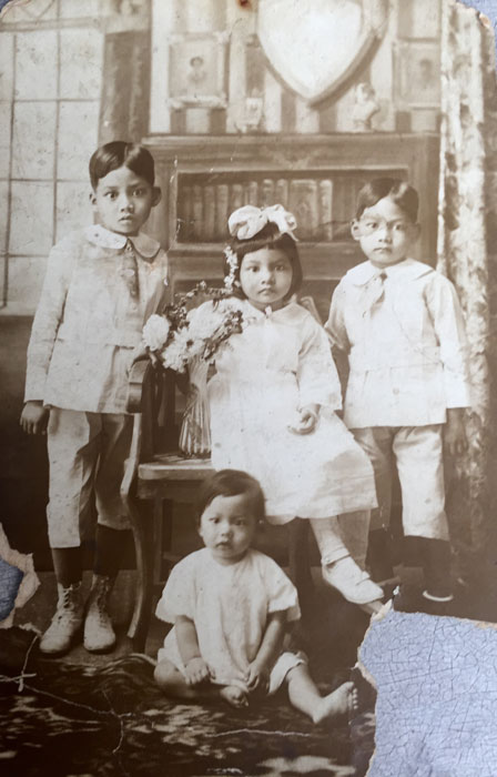 The first four Licad siblings of nine (the 10th died after birth): Bienvenido, Gloria, Felicissimo , and Jesus.