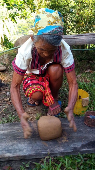 Com-as Sangga about to make s pot from a lump of clay. (Photo by Lourdes Guieb-Demetillo)