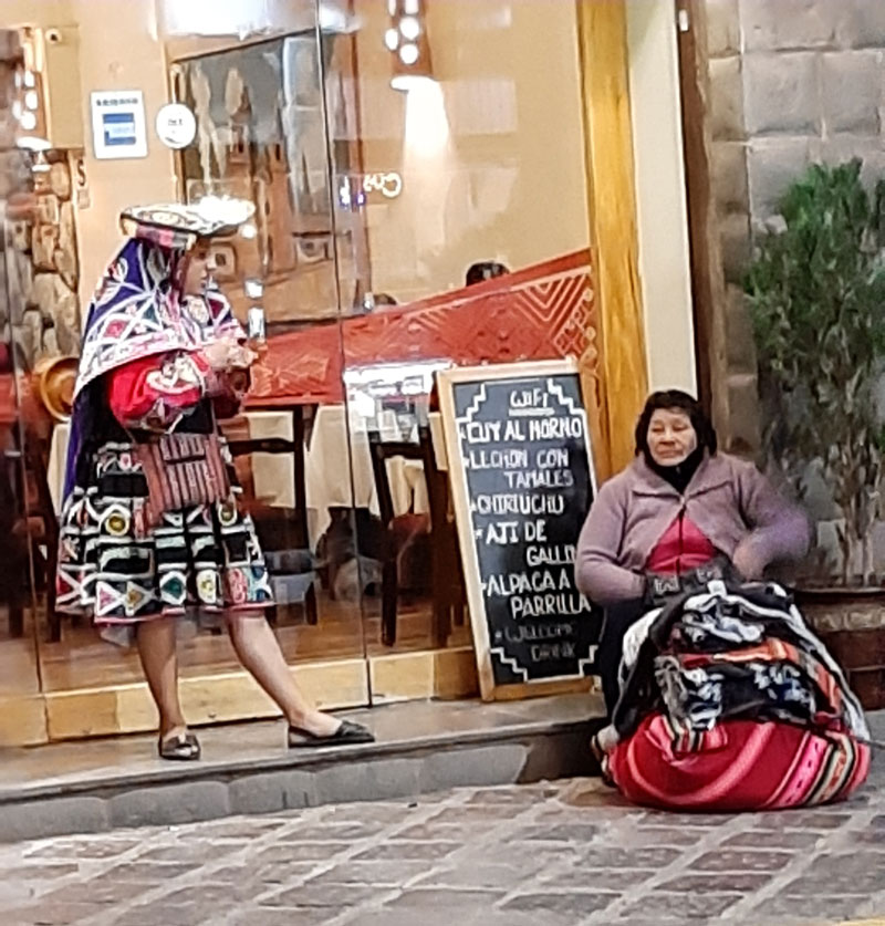 Women in local color hanging out at a restaurant in Cusco (Photo by Bella Bonner)