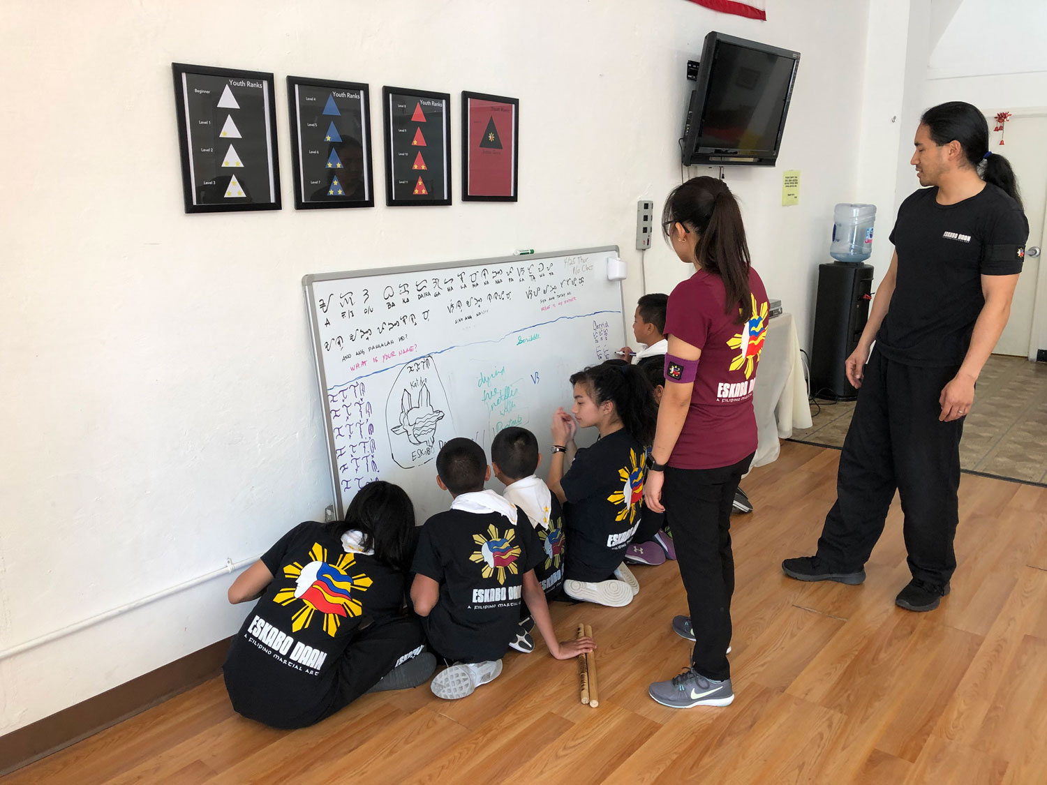 Kids practice their Baybayin.